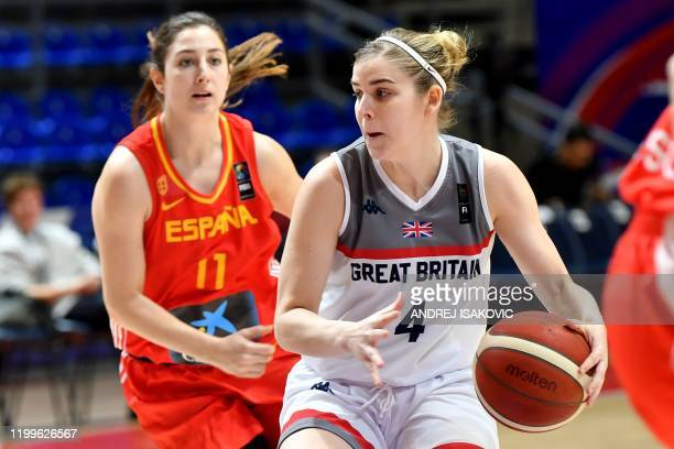 Britain's Georgia Jones drives the ball in front of Spain's Leonor Rodriguez during the FIBA Womens Olympic qualifying basketball tournament match...