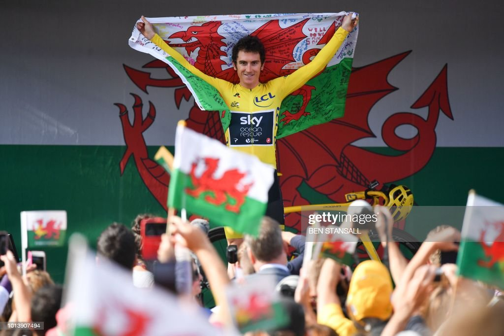 TOPSHOT - Britain's Geraint Thomas gestures to the crowd during a celebratory homecoming event in Cardiff, south Wales, on August 9, 2018 following Thomas's victory in the Tour de France cycling race. - Geraint Thomas was labelled the 'Perfect Poster Boy' after the British Team Sky rider deposed teammate and four-time champion Chris Froome to win the Tour de France. The two-time Olympic gold medallist finished the race in Paris with a cushion of nearly two minutes over Dutch rival Tom Dumoulin (Sunweb) to secure his first yellow jersey, with Froome in third.