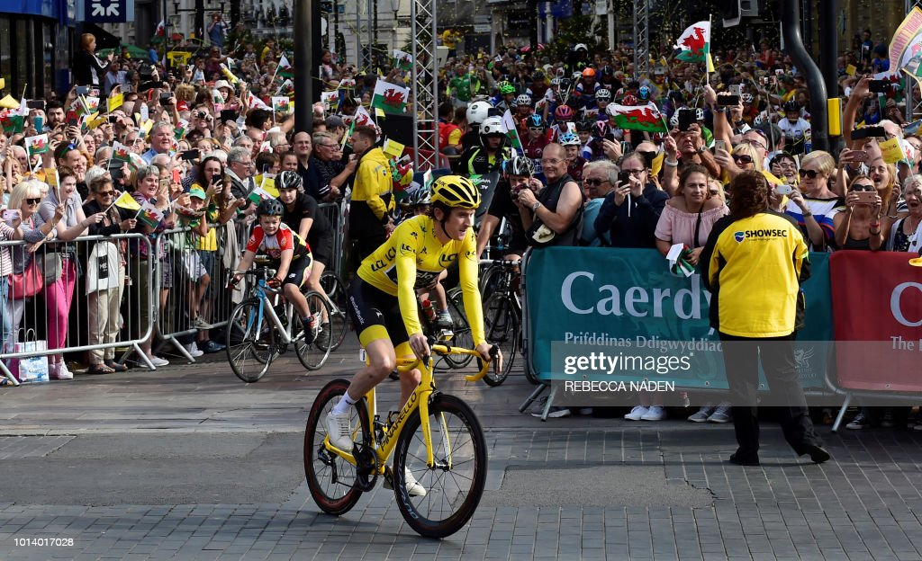 Britain's Geraint Thomas rides during a celebratory homecoming event in Cardiff, south Wales, on August 9, 2018 following Thomas's victory in the Tour de France cycling race. - Geraint Thomas was labelled the 'Perfect Poster Boy' after the British Team Sky rider deposed teammate and four-time champion Chris Froome to win the Tour de France. The two-time Olympic gold medallist finished the race in Paris with a cushion of nearly two minutes over Dutch rival Tom Dumoulin (Sunweb) to secure his first yellow jersey, with Froome in third.