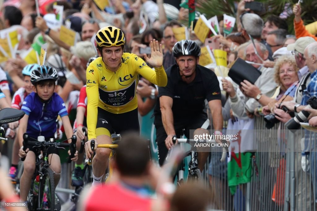 Britain's Geraint Thomas waves during a celebratory homecoming event in Cardiff, south Wales, on August 9, 2018 following Thomas's victory in the Tour de France cycling race. - Geraint Thomas was labelled the 'Perfect Poster Boy' after the British Team Sky rider deposed teammate and four-time champion Chris Froome to win the Tour de France. The two-time Olympic gold medallist finished the race in Paris with a cushion of nearly two minutes over Dutch rival Tom Dumoulin (Sunweb) to secure his first yellow jersey, with Froome in third.