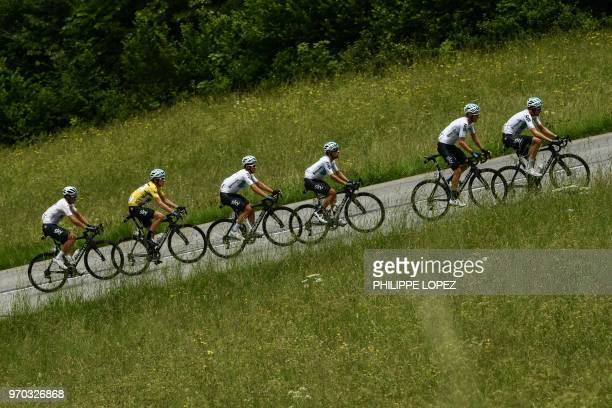 Britain's Geraint Thomas wearing the overall leader's yellow jersey and his Great Britain's Sky cycling team partners Italy's Gianni Moscon Poland's...