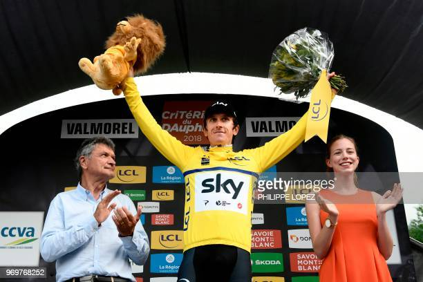 Britain's Geraint Thomas, wearing the overall leader's yellow jersey, celebrates on the podium after the fifth stage of the 70th edition of the...