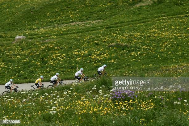 Britain's Geraint Thomas wearing the overall leader's yellow jersey rides with his Great Britain's Sky cycling team partners Italy's Gianni Moscon...