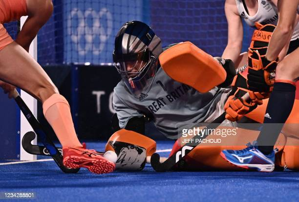 Britain's goalkeeper Madeleine Claire Hinch dives for the ball during the women's pool A match of the Tokyo 2020 Olympic Games field hockey...