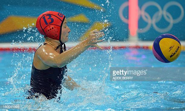 Britain's goalkeeper Robyn Nicholls blocks the ball a ball from Italy during the women's water polo classification 5th/8th round match at the London...