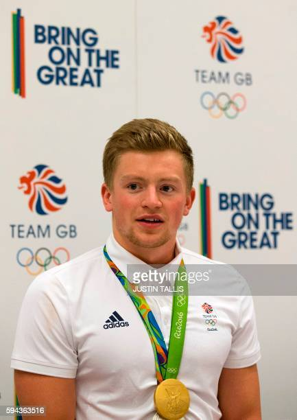 Britain's gold medal winning swimmer Adam Peaty speaks to members of the media at a press conference after arriving back from the Rio 2016 Olympic...