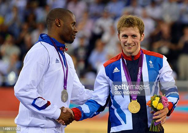 Britain's gold medalist Jason Kenny shakes hands with France's silver medalist Gregory Bauge on the podium after winning the London 2012 Olympic...