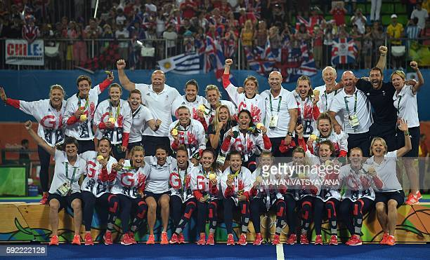 Britain's gold medallists celebrate on the podium during the women's field hockey medals ceremony of the Rio 2016 Olympics Games at the Olympic...