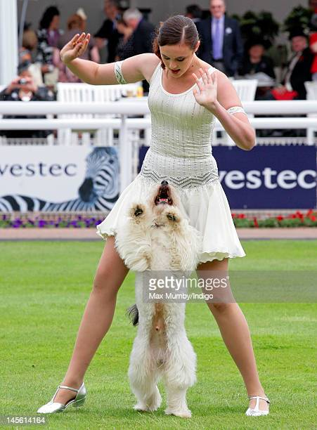 Britains Got Talent 2012 Winners Ashleigh Butler and her dog Pudsey perform at the Investec Derby Festival horse racing meeting at Epsom Racecourse...