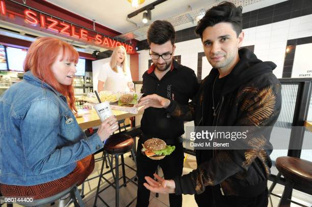 The Smash Crew carry placards during the launch of the new Smashburger on June 21 2018 in Brighton England Britain's Got Talent semifinalist...