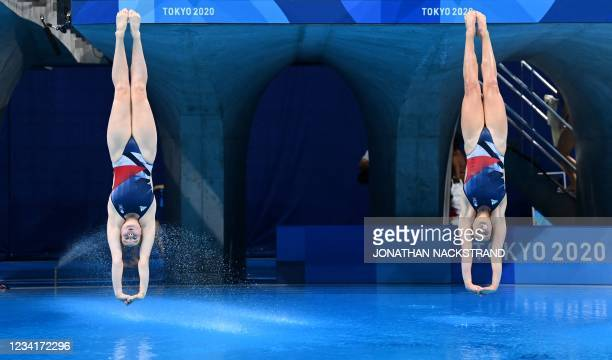 Britain's Grace Reid and Britain's Katherine Torrance compete in the women's synchronised 3m springboard diving final event during the Tokyo 2020...