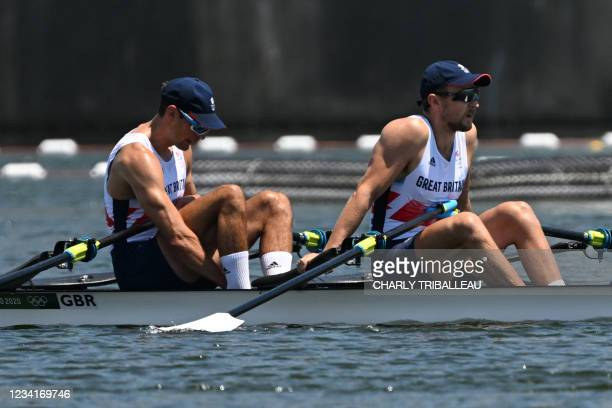 Britain's Graeme Thomas and Britain's John Collins react after the men's double sculls semi-final during the Tokyo 2020 Olympic Games at the Sea...