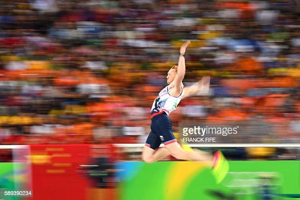 TOPSHOT Britain's Greg Rutherford competes in the Men's Long Jump Final during the athletics event at the Rio 2016 Olympic Games at the Olympic...