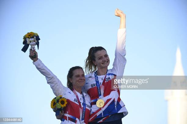 Britain's Hannah Mills and Eilidh Mcintyre celebrate on the podium with their gold medals after the women's two-person dinghy 470 medal race during...