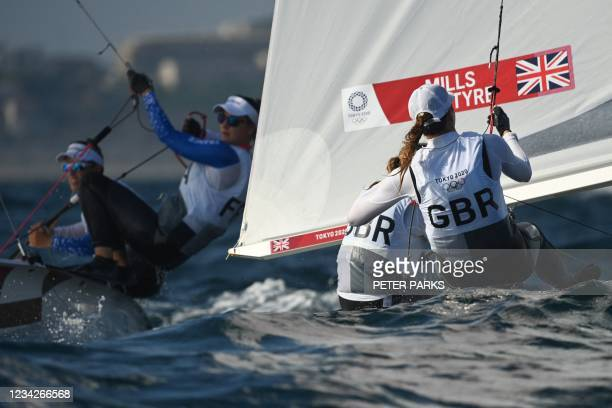 Britain's Hannah Mills and Eilidh McIntyre compete in the women's two-person dinghy 470 race 1 during the Tokyo 2020 Olympic Games sailing...