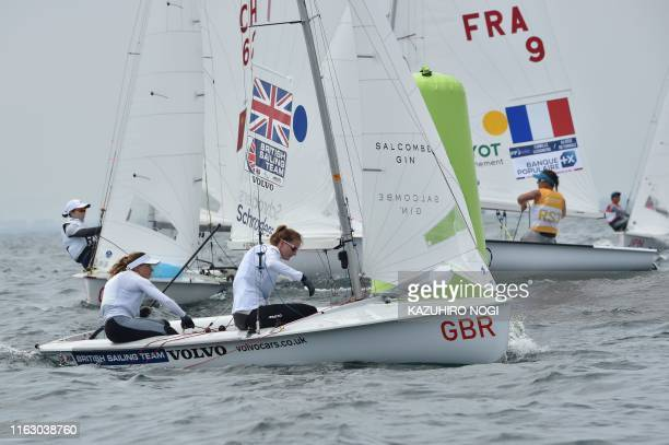 Britain's Hannah Mills and Eilidh Mcintyre compete in the women's two person dinghy 470 class competition during a sailing test event for the Tokyo...