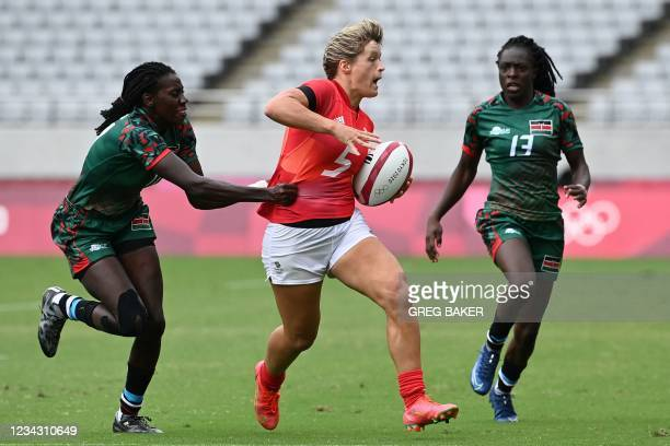 Britain's Hannah Smith is chased by Kenya's Diana Ochieng and Camilla Atieno during the women's pool A rugby sevens match between Britain and Kenya...