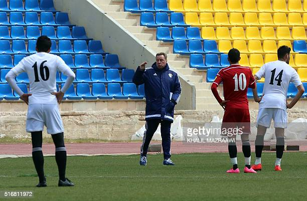 Britain's Harry Redknapp a former Tottenham boss who was nominated as the new manager of Jordan's national team speaks with the Jordanian players...