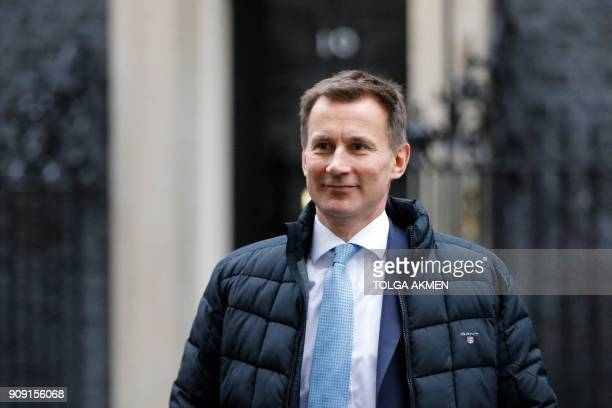 Britain's Health and Social Care Secretary Jeremy Hunt leaves after attending the weekly cabinet meeting at number 10 Downing Street in central...