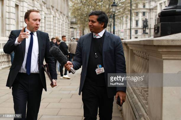 Britain's Health and Social Care Secretary Matt Hancock speaks with Sky News reporter Faisal Islam on Whitehall in London England on April 8 2019...