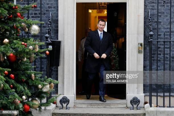 Britain's Health Secretary Jeremy Hunt leaves after attending the weekly meeting of the Cabinet at 10 Downing Street in central London on December 5...