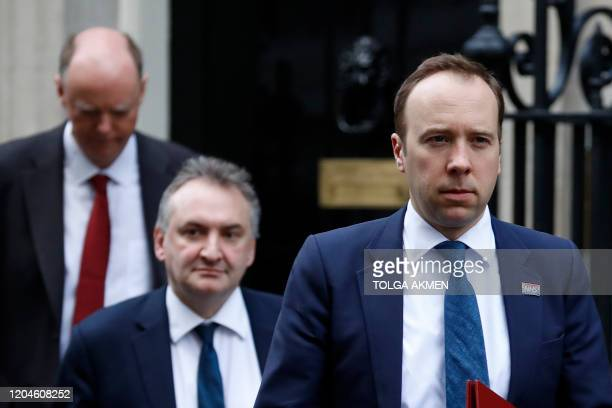 Britain's Health Secretary Matt Hancock and Britain's Chief Medical Officer for England Chris Whitty leave from 10 Downing Street in central London...