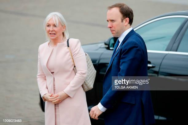 Britain's Health Secretary Matt Hancock and health minister Nadine Dorries visit the ExCeL London exhibition centre which has been transformed into...