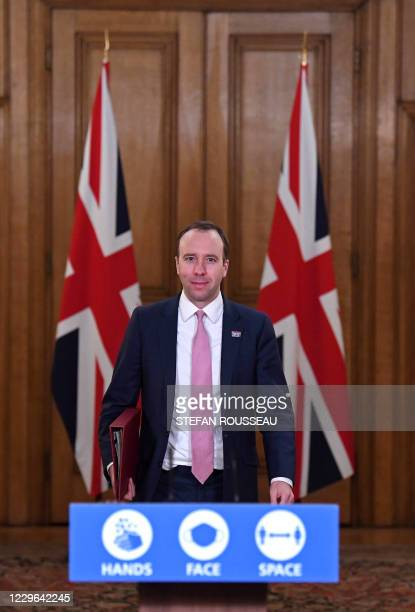 Britain's Health Secretary Matt Hancock arrives to host a remote press conference to update the nation on the covid19 pandemic inside 10 Downing...