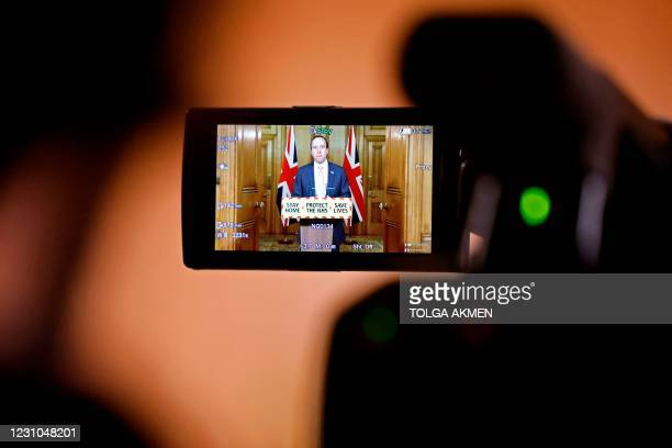 Britain's Health Secretary Matt Hancock is pictured on the screen of a Television Camera as he attends a virtual press conference inside 10 Downing...