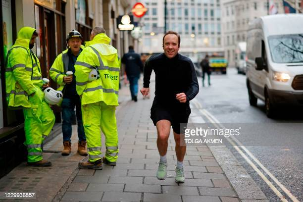 Britain's Health Secretary Matt Hancock poses running past photographers whilst out for a morning jog in Westminster central London on December 4,...