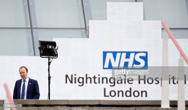 Britain's Health Secretary Matt Hancock speaks during a television interview at the opening of the NHS Nightingale field hospital created at the...