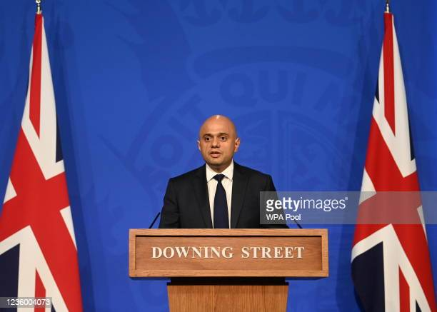 Britain's Health Secretary Sajid Javid speaks during a press conference at Downing Street on October 20, 2021 in London, England. In the UK over the...