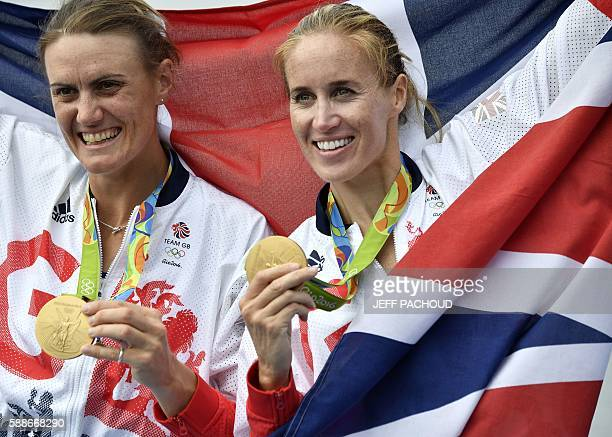 Britain's Heather Stanning and Britain's Helen Glover pose with their medals on the podium of the Women's Pair final rowing competition at the Lagoa...