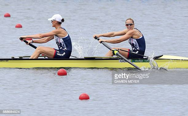 Britain's Heather Stanning and Britain's Helen Glover row to win the Women's Pair final rowing competition at the Lagoa stadium during the Rio 2016...