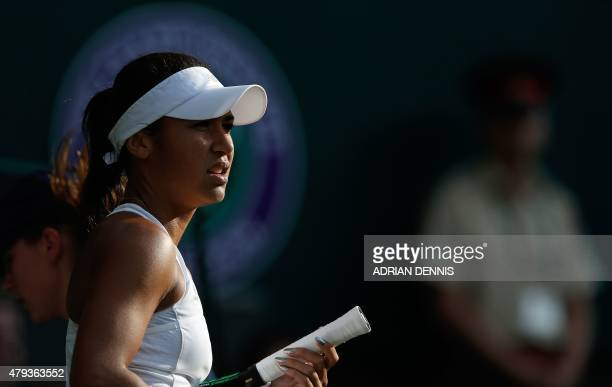 Britain's Heather Watson pauses during a break against US player Serena Williams during their women's singles third round match on day five of the...