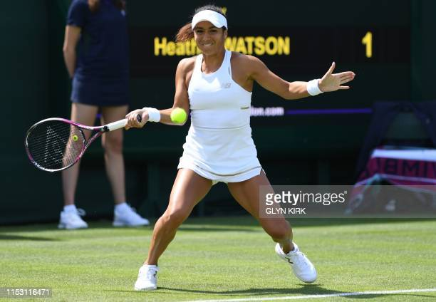 Britain's Heather Watson returns against US player Cate McNally during their women's singles first round match on the first day of the 2019 Wimbledon...