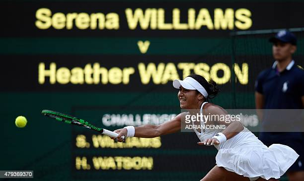 Britain's Heather Watson returns to US player Serena Williams during their women's singles third round match on day five of the 2015 Wimbledon...