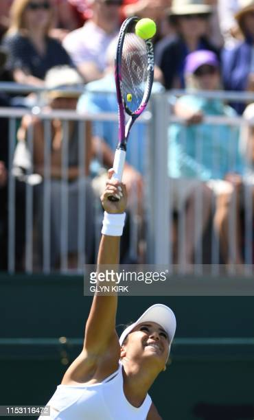 Britain's Heather Watson serves against US player Cate McNally during their women's singles first round match on the first day of the 2019 Wimbledon...