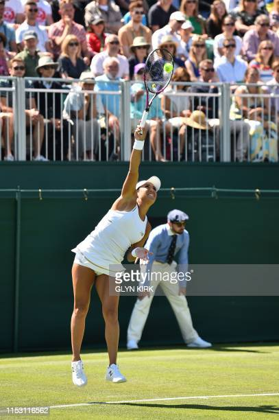 Britain's Heather Watson serves agtainst US player Cate McNally during their women's singles first round match on the first day of the 2019 Wimbledon...