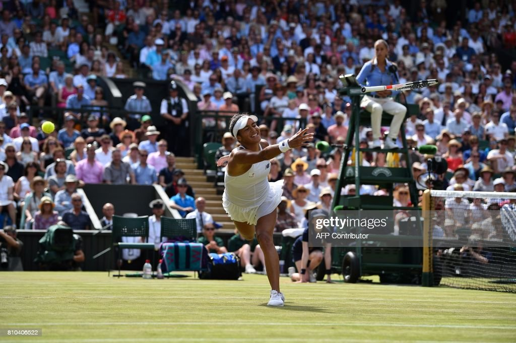 TOPSHOT - Britain's Heather Watson throws her racquet to try to hit the ball in a return against Belarus's Victoria Azarenka during their women's singles third round match on the fifth day of the 2017 Wimbledon Championships at The All England Lawn Tennis Club in Wimbledon, southwest London, on July 7, 2017. / AFP PHOTO / Glyn KIRK / RESTRICTED