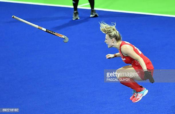 Britain's Hollie Webb jumps to celebrate after scoring a goal during the penalty shootout at the end of the women's Gold medal hockey Netherlands vs...
