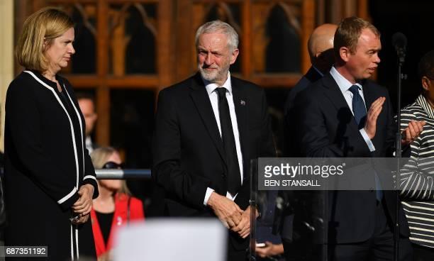 Britain's Home Secretary Amber Rudd Britain's main opposition Labour Party leader Jeremy Corbyn and Liberal Democrat leader Tim Farron attend a vigil...