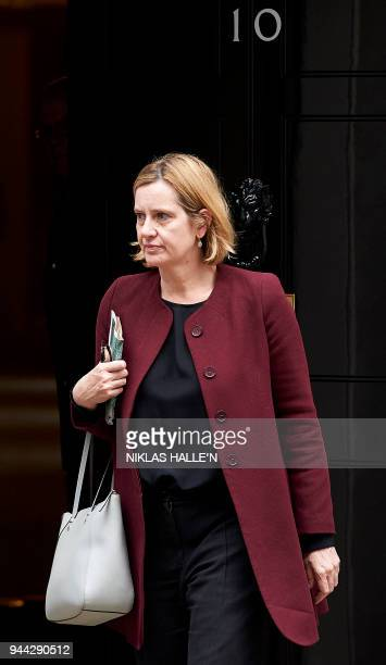 Britain's Home Secretary Amber Rudd leaves from 10 Downing street after attending a National Security Council meeting in London on April 10 2018 /...