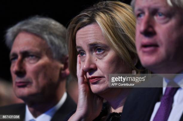 Britain's Home Secretary Amber Rudd listens to the speech by Britain's Prime Minister Theresa May on the final day of the Conservative Party annual...