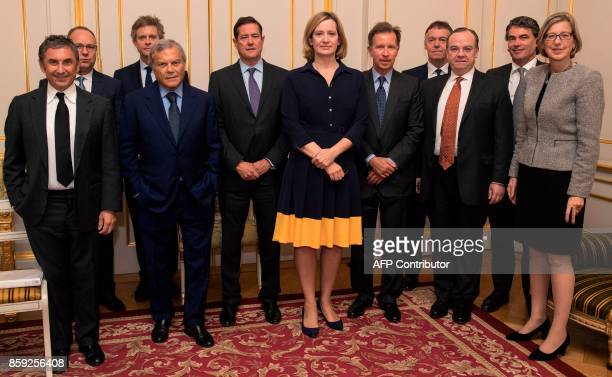 Britain's Home Secretary Amber Rudd poses for a photograph with Burberry CEO Marco Gobbetti Anglo American CEO Mark Cutifani Associated British Foods...