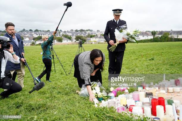 Britain's Home Secretary Priti Patel arrives to lay a floral tribute to the victims of the August 12 shootings in Plymouth, in North Down Crescent...