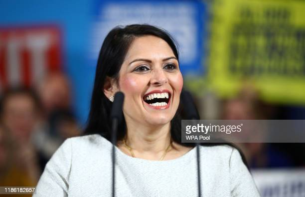 Britain's Home Secretary Priti Patel reacts during a campaign rally event on December 2, 2019 in Colchester, England.