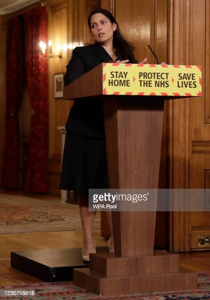 Britain's Home Secretary Priti Patel, speaks during a media briefing on the COVID-19 pandemic in Downing Street on January 21, 2021 in London,...