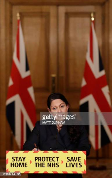 Britain's Home Secretary Priti Patel speaks during a virtual press conference on the novel coronavirus COVID-19 pandemic, at 10 Downing Street in...