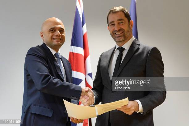 Britain's Home Secretary Sajid Javid and French Interior Minister Christophe Castaner take part in a signing ceremony for a new action plan to...